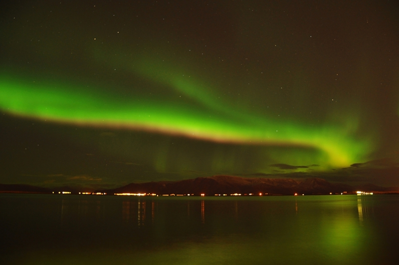 Work with a tour company to find the best spot to catch the Northern Lights.